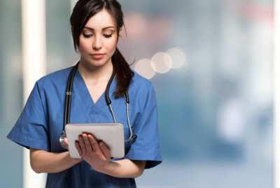nurse using a tablet