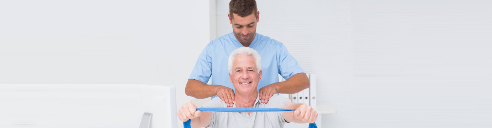 therapist massaging a senior man