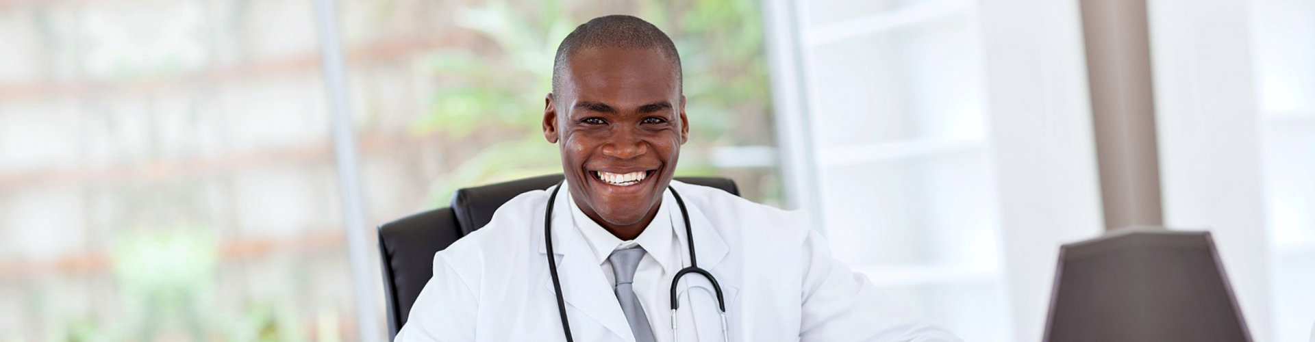 happy doctor in his office